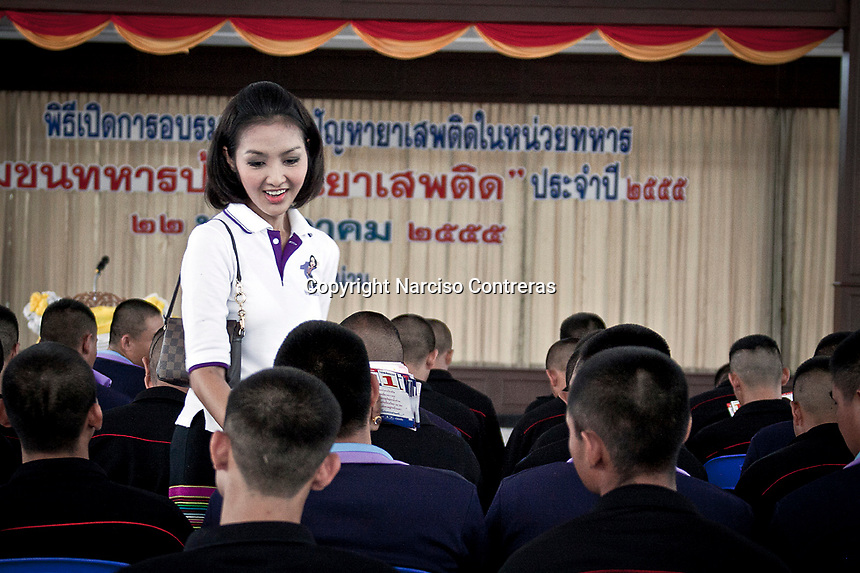 """YOLLANDA """"NOK"""" SUANYOT speaks with soldiers as she stands for elections in northern Nan province, Thailand. Known formerly as a beauty queen, is running today a political campaign for the local rule of Nan city. 30-year-old Yollada Suanyot, who was born a male, has become the first transgender to register as an election candidate. The upcoming elections will be held on May 27th in 24 constituencies in 15 districts. In accord with the Thai media this is the first time in Thailand that a transgender is taking part in a provincial election."""