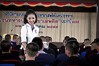 "YOLLANDA ""NOK"" SUANYOT speaks with soldiers as she stands for elections in northern Nan province, Thailand. Known formerly as a beauty queen, is running today a political campaign for the local rule of Nan city. 30-year-old Yollada Suanyot, who was born a male, has become the first transgender to register as an election candidate. The upcoming elections will be held on May 27th in 24 constituencies in 15 districts. In accord with the Thai media this is the first time in Thailand that a transgender is taking part in a provincial election."