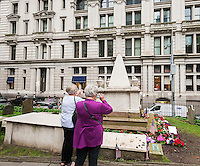 """The grave of Alexander Hamilton in Trinity Church's cemetery in the Financial District of New York on Thursday, June 16, 2016. Because of the success of the musical """"Hamilton"""" on Broadway sites associated with him have seen an increase in interest and tourist traffic. (©Richard B. Levine)"""
