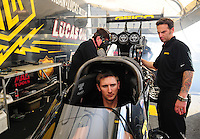 Jan. 17, 2012; Jupiter, FL, USA: NHRA top fuel dragster driver Morgan Lucas sits in the car as crew chief Aaron Brooks (right) works on the engine during testing at the PRO Winter Warmup at Palm Beach International Raceway. Mandatory Credit: Mark J. Rebilas-