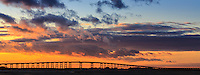 Beautiful cloudy sunset with the Oregon Inlet bridge silhouetted in the foreground.