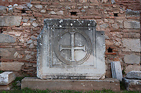 DELPHI, GREECE - APRIL 12 : A detail of an engraved cross, on April 12, 2007 in the Roman Agora in  the Sanctuary of Apollo, Delphi, Greece. The Roman Agora is used as a storage of antiquities for the archaeological site. (Photo by Manuel Cohen)
