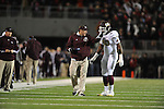 Ole Miss vs. Mississippi State Coach Dan Mullen talks to Mississippi State defensive lineman Denico Autry (90) after he recived a penalty at Vaught Hemingway Stadium in Oxford, Miss. on Saturday, November 24, 2012. Ole Miss won 41-24.