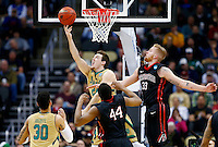 PITTSBURGH, PA - MARCH 19:  Pat Connaughton #24 of the Notre Dame Fighting Irish shoots against the defense of Zach Stahl #33 and Reggie Spencer #44 of the Northeastern Huskies in the second half during the second round of the 2015 NCAA Men's Basketball Tournament at Consol Energy Center on March 19, 2015 in Pittsburgh, Pennsylvania.  (Photo by Jared Wickerham/Getty Images)