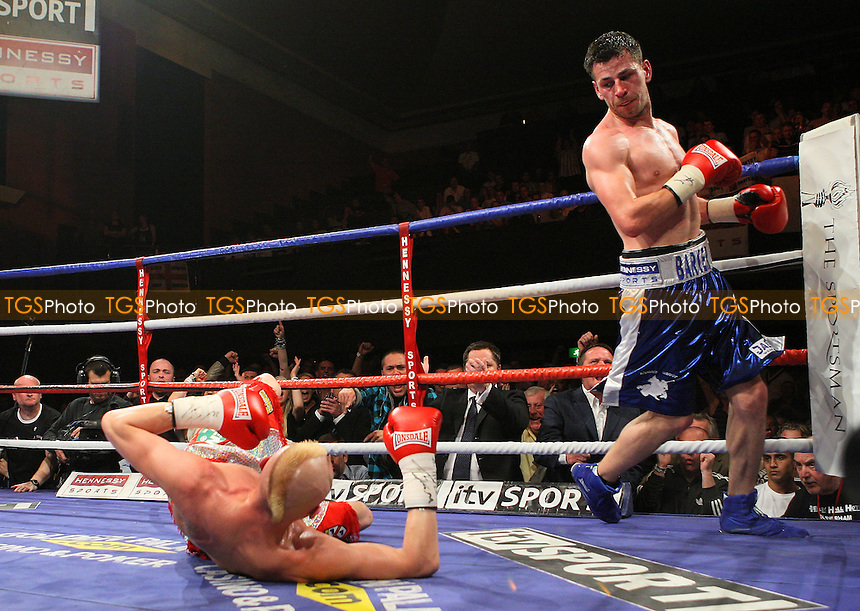 Darren Barker (Barnet, blue shorts) defeats Darren McDermott (Dudley, silver/red shorts) in a Middleweight Boxing contest for the Commonwealth Title at the Colosseum, Watford, Hertforshire, promoted by Mick Hennessy / Hennessy Sports - 23/05/09 - MANDATORY CREDIT: Gavin Ellis/TGSPHOTO - Self billing applies where appropriate - 0845 094 6026 - contact@tgsphoto.co.uk - NO UNPAID USE.