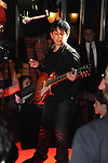 Bar Mitzvah boy plays rock on his Gibson guitar at his gala party.