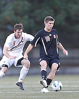 Brown University midfielder Bobby Belair (10) passes the ball as Boston College defender Nick Corliss (5) closes. Brown University (black) defeated Boston College (white), 1-0, at Newton Campus Field, October 16, 2012.