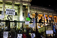 People climb a fence as they protest against the policies government of Argentina's President Cristina Fernandez in Buenos Aires April 18, 2013. Photo by Juan Gabriel Lopera / VIEWpress.