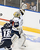 Jeff Silengo (UNH - 18), Mike Johnson (Notre Dame - 32) - The University of Notre Dame Fighting Irish defeated the University of New Hampshire Wildcats 2-1 in the NCAA Northeast Regional Final on Sunday, March 27, 2011, at Verizon Wireless Arena in Manchester, New Hampshire.