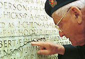 "Canadian veteran Richard Ross points at the name ""F. Hucker"" that has been worn down...Photo taken 10 May 2000 at the Canadian War Memorial at Vimy, France..Credit: Justin Jin"