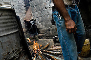 A Cuban man sets up the fire, required for a Palo religion ceremony, on the backyard of his house in Santiago de Cuba, Cuba, August 1, 2009. The Palo religion (Las Reglas de Congo) belongs to the group of syncretic religions which developed in Cuba amongst the black slaves, originally brought from Congo during the colonial period. Palo, having its roots in spiritual concepts of the indigenous people in Africa, worships the spirits and natural powers but can often give them faces and names known from the Christian dogma. Although there have been strong religious restrictions during the decades of the Cuban Revolution, the majority of Cubans still consult their problems with practitioners of some Afro Cuban religion.