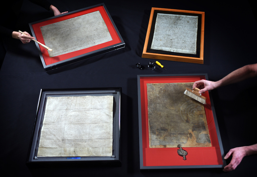 UNITED FOR THE FIRST TIME IN HISTORY:THE ORIGINAL SURVIVING MAGNA CARTA MANUSCRIPTS BEING PREPARED FOR DISPLAY AT THE BRITISH LIBRARY.  PHOTO BY CLARE KENDALL/BRITISH LIBRARY.