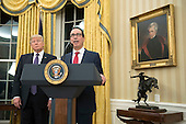 Treasury Secretary Seven Mnuchin delivers remarks alongside President Donald Trump after being sworn-in as Treasury Secretary during a ceremony at the White House in Washington, D.C. on February 13, 2017. Mnuchin was confirmed by the Senate 54-47 earlier today. <br /> Credit: Kevin Dietsch / Pool via CNP