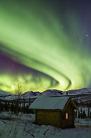 Aurora over the Wolf run cabin in the White Mountains National Recreation Area in interior Alaska.