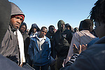 African asylum-seekers prepare to resume walking after a break from a protest march, along a road north of Be'er Sheva, Israel. Some 200 African asylum-seekers, who illegally entered Israel, demonstrated against their condition at a detention facility, from which they walked out of two days earlier. At the end of the walk in Jerusalem, Israeli police and immigration arrested all protestors, and sent them back to Saharonim detention facility in the Negev desert.