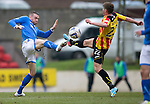 St Johnstone v Partick Thistle...29.03.14    SPFL<br /> James Dunne and Gary Fraser<br /> Picture by Graeme Hart.<br /> Copyright Perthshire Picture Agency<br /> Tel: 01738 623350  Mobile: 07990 594431
