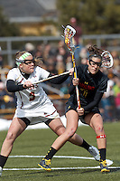 University of Maryland midfielder Katie Schwarzmann (7) on the attack as Boston College defender Ali Meagher (9) defends..University of Maryland (black) defeated Boston College (white), 13-5, on the Newton Campus Lacrosse Field at Boston College, on March 16, 2013.