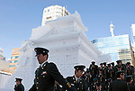 Members of Japan's Ground Self Defense Forces exit the stage after gathering for a group photo in front of one of their creations during the Sapporo Snow and Ice Festival in Sapporo City, northern Japan on Feb 4 2008. The SDF is charged with many of the duties involved in the festival, from trucking in pure white snow to building many of the sculptures on display.