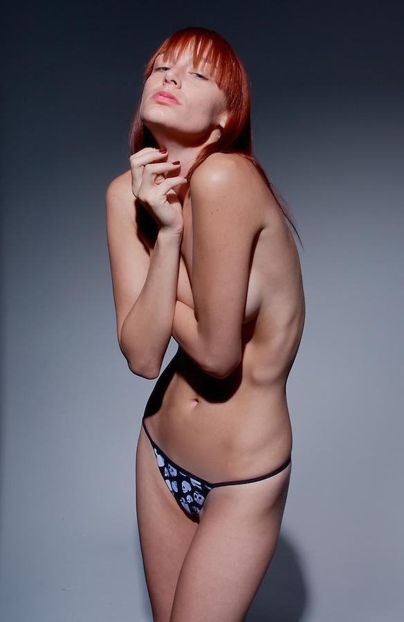 Sensual red-hair model nude.