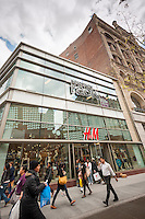 A newly opened Nordstrom Rack and a T.J. Maxx join the H&M department store in Downtown Brooklyn in New York on Friday, May 2, 2014. The area has been for years a middle and lower economic shopping strip but because of increased development in the area, notably hi-rise luxury apartment buildings, chain stores and high-end retailers are moving in. Rents are rising and the smaller mom and pop stores, as well as regional chains are being forced out.  (© Richard B. Levine)
