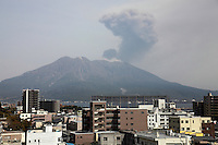 Sakurajima Volcano erupting, with ash cloud rising from Japans most active volcano viewed from Kagoshima, 2012.