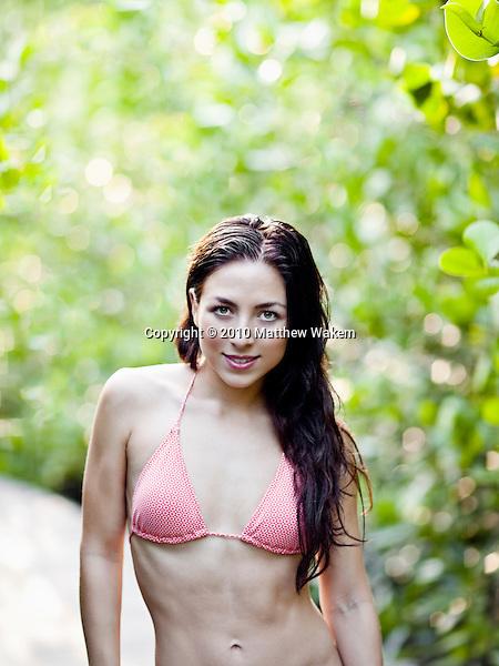 Woman in Bikini along the mangrove path at  Six Senses Hideaway Yao Noi, Koh Yao Noi, Thailand.
