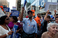 Social groups protest againts US corporations as they march by the 7th avenue during  tax day in New York April 8, 2012. Photo by Joana Toro / VIEWpress.