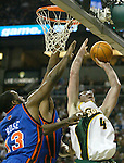 New York Knicks' Malik Rosa, left, and Michael Sweetney, middle, try to block Seattle SuperSonics' Nick Collison's jumpshot, right, during the first half of their game at Key Arena in Seattle, Washington Friday, 25 March 2005. Jim Bryant Photo. &copy;2010. All Rights Reserved.