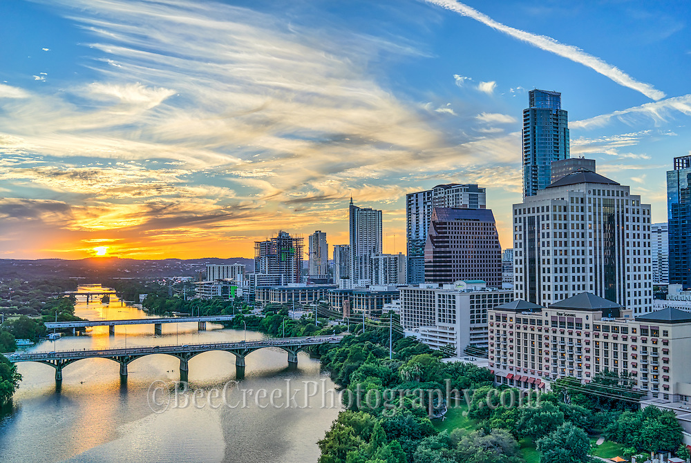 We captured this aerial image of the skyline along LadyBird Lake at sunset with the Congress Bridge, First street bridge, Lamar Bridge all the way down the lake with the cityscape in view.
