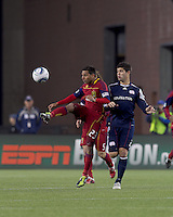 Real Salt Lake forward Paulo Araujo Jr. (23) attempts to control the ball as New England Revolution defender Franco Coria (2) defends. In a Major League Soccer (MLS) match, Real Salt Lake defeated the New England Revolution, 2-0, at Gillette Stadium on April 9, 2011.