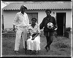 "Thembisa ""Portia"" Mtokwana (23), with her parents, Gunguletu Township, Cape Town, South Africa, 1998"