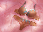 Beige lingerie still life womens lace underwear on pink background