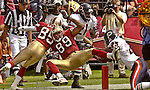 San Francisco 49ers wide receiver Brandon Lloyd (85) helps Tai Streets (89) make touchdown in second quarter on Sunday, September 7, 2003, in San Francisco, California. The 49ers defeated the Bears 47-7.