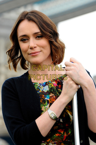 Keeley Hawes .The P&G Capital Clean Up launch campaign photocall, Potters Field Park, London, England..March 8th, 2012.half length  red green print dress black cardigan .CAP/CJ.©Chris Joseph/Capital Pictures.