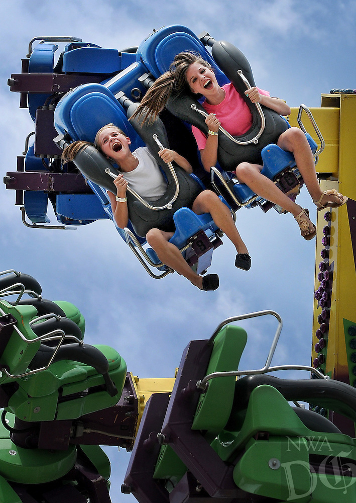 NWA Media/BEN GOFF  @NWABenGoff -- 08/16/14 Brittney Easley, left, and Lexxi Vahle (CQ), both 14 and from Gravette, take a whirl on the Power Surge ride at the Benton County Fair near Bentonville on Saturday August 16, 2014.