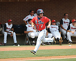 Mississippi's Zach Miller (1) scores vs. St. John's during an NCAA Regional game at Davenport Field in Charlottesville, Va. on Sunday, June 6, 2010.