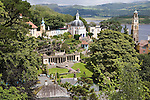"Portmeirion, in North Wales, is a resort, where no one has ever lived. A self-taught Welsh architect named Sir Clough Williams-Ellis built it out of architectural salvage between the 1920s and 1970s, loosely based on his memories of trips to Portofino. Including a pagoda-shaped Chinoiserie gazebo, some Gothic obelisks, eucalyptus groves, a crenellated castle, a Mediterranean bell tower, a Jacobean town hall, and an Art Deco cylindrical watchtower. He kept improving Portmeirion until his death in 1978, age 94. It faces an estuary where at low tide one can walk across the sands and look out to sea. At high tide, the sea is lapping onto the shores. Every building in the village is either a shop, restaurant, hotel or self-catering accomodation. The village is booked out at high season, with numerous wedding receptions at the weekends. Very popular amongst the English and Welsh holidaymakers. Many who return to the same abode season after season. Hundreds of tourists visit every day, walking around the ornamental gardens, cobblestone paths, and shopping, eating ice-creams, or walking along the woodland and coastal paths, amongst a colourful assortment of hydrangea, rhododendrons, tree ferns and redwoods. The resort boasts two high class hotels, a la carte menus, a swimming pool, a lifesize concrete boat, topiary, pools and wishing wells. The creator describes the resort as ""a home for fallen buildings,"" and its ragged skyline and playful narrow passageways which were meant to provide ""more fun for more people."" It does just that.///View across Portmeirion from the Gazebo, Sir Clough Wiliams-Ellis' favorite vantage point above his creation"