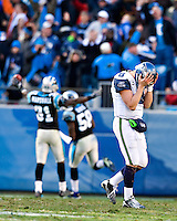 CHARLOTTE, NC - DECEMBER 16:   Matt Hasselbeck #8 of the Seattle Seahawks reacts after a fumble at the end of the game against the Carolina Panthers at Bank of America Stadium on December 16, 2007 in Charlotte, North Carolina.  The Panthers defeated the Seahawks 13-10.  (Photo by Wesley Hitt/Getty Images) *** Local Caption *** Matt Hasselbeck.