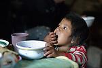 Three-year old Nyda Diaz Vasquez eats breakfast in her home in Tuixcajchis, a small Mam-speaking Maya village in Comitancillo, Guatemala.