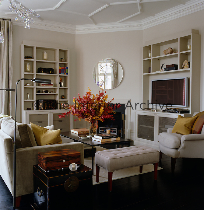 The furniture in the living room is grouped around the television and fireplace