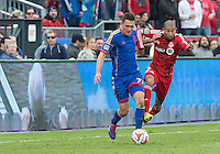 Toronto, Ontario - April 12, 2014: Colorado Rapids defender Shane O'Neill #27 and Toronto FC defender Justin Morrow #2 in action during the 2nd half in a game between the Colorado Rapids and Toronto FC at BMO Field in Toronto.<br /> Colorado Rapids won 1-0.