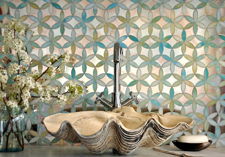 Fiona, a jewel glass waterjet mosaic shown in Aquamarine and Dusk Mirror, is part of the Silk Road Collection by Sara Baldwin for New Ravenna Mosaics.