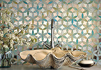 Fiona, a handmade mosaic shown in Aquamarine jewel glass and Dawn mirror, is part of the Silk Road Collection by Sara Baldwin for New Ravenna. <br />
