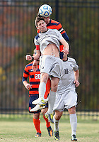 WASHINGTON, DC - NOVEMBER 25, 2012: Steve Neumann (18) of Georgetown University goes up for a header with Ted Cribley (5) of Syracuse University during an NCAA championship third round match at North Kehoe field, in Georgetown, Washington DC on November 25. Georgetown won 2-1 after overtime and penalty kicks.