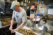 Chapel Hill, North Carolina - Thursday September 10, 2015 - Bill Smith, chef of Crook's Corner in Chapel Hill, North Carolina, prepares softshell crabs in the kitchen the morning of Thursday September 10, 2015. Smith has a new cookbook coming out featuring recipes for crabs and oysters.