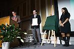 Ohio University's Interim President, David Descutner, left, and 2016 Distinguished Professor recipient, Dr. Gerardine Botte, right, unveil the 2017 Distinguished Professor portrait of Dr.  Alexander Govorov at Ohio University's Baker Center Ballroom on Monday, February 20, 2017.