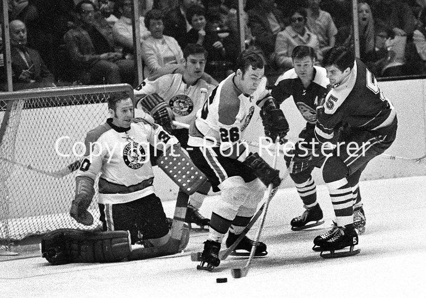 Seals vs Penguins..1970. #26 and goal Les Binkley battle Carol Vadnais..(photo/Ron Riesterer)