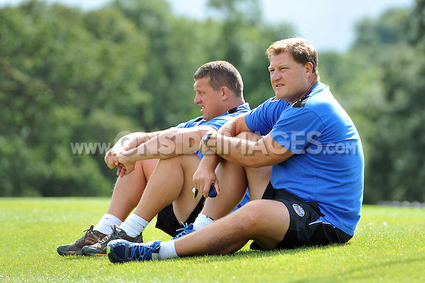 First team coach Toby Booth and Forwards coach Neal Hatley watch visiting rugby league side Wigan Warriors train. Bath Rugby pre-season training session on August 18, 2014 at Farleigh House in Bath, England. Photo by: Patrick Khachfe/Onside Images