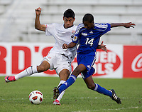 Esteban Rodriguez (8) of the United States andYosel Piedra (14) of Cuba fight for the ball during the first day of the group stage at the CONCACAF Men's Under 17 Championship at Catherine Hall Stadium in Montego Bay, Jamaica. The United States defeated Cuba, 3-1.