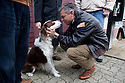 CLAREMONT, NH - JANUARY 09: Republican presidential candidate and former Utah Gov. Jon Huntsman gets a kiss from a dog named 'Jeter' as he campaigns on January 09, 2012 in Claremont, New Hampshire. Polls show Huntsman gaining ground on front runner Mitt Romney ahead of Tuesday's primary. (Photo by Matthew Cavanaugh/Getty Images)
